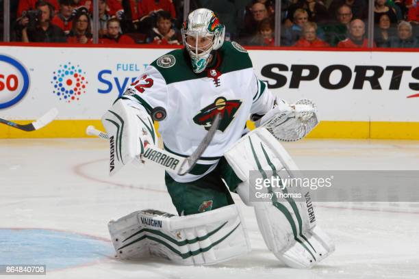 Alex Stalock of the Minnesota Wild stops the puck in an NHL game against the Minnesota Wild at the Scotiabank Saddledome on October 21 2017 in...