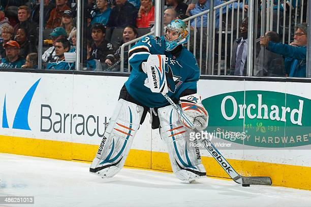 Alex Stalock of the San Jose Sharks controls the puck against the Colorado Avalanche at SAP Center on April 11 2014 in San Jose California