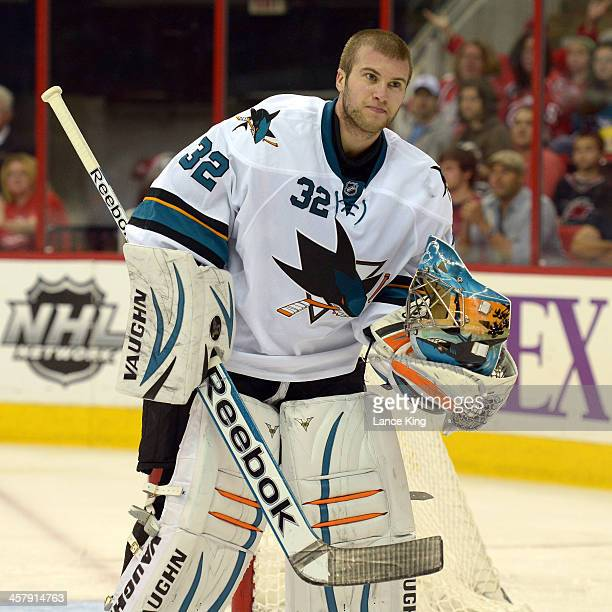 Alex Stalock of the San Jose Sharks looks on against the Carolina Hurricanes at PNC Arena on December 6 2013 in Raleigh North Carolina The Hurricanes...