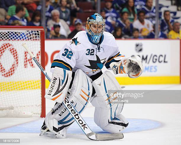 Alex Stalock of the San Jose Sharks skates against the Vancouver Canucks during a preseason NHL game at Rogers Arena on September 16 2013 in...