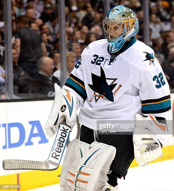 Alex Stalock of the San Jose Sharks takes a break during the second period in Game Six of the First Round of the 2014 NHL Stanley Cup Playoffs at...