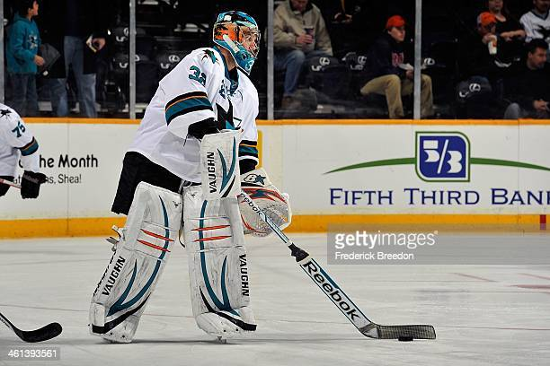 Alex Stalock of the San Jose Sharks warms up prior to a game against the Nashville Predators at Bridgestone Arena on January 7 2014 in Nashville...