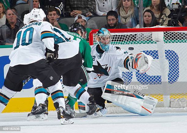 Alex Stalock of the San Jose Sharks watches a shot into his glove against the Dallas Stars at the American Airlines Center on November 8 2014 in...