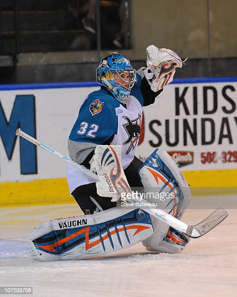 Alex Stalock of the Worcester Sharks makes a save during action against the Charlotte Checkers at the DCU Center on November 27 2010 in Worcester...