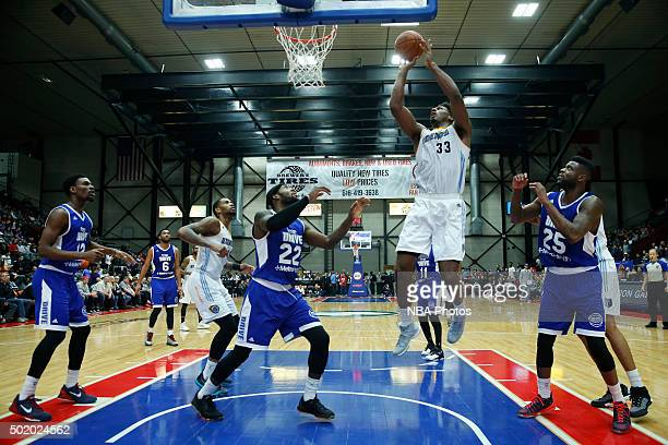 Alex Stepheson of the Iowa Energy shoots against Branden Dawson and Reggie Bullock of the Grand Rapids Drive during the second half of an NBA DLeague...