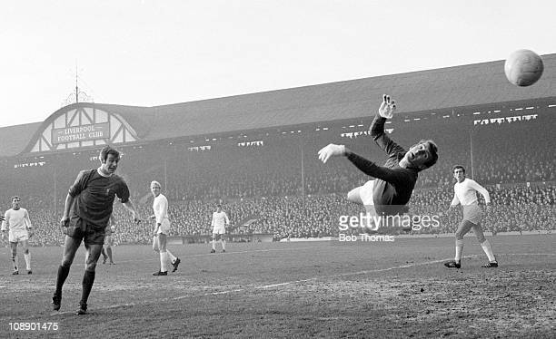Alex Stepney of Manchester United makes an acrobatic save against Bobby Graham of Liverpool during their Division One match played at Anfield...