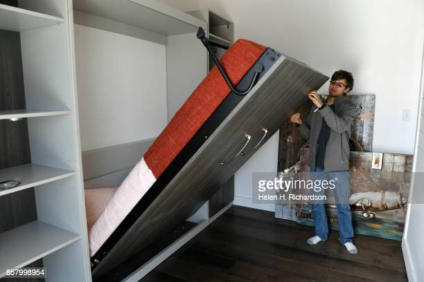 DENVER CO OCTOBER 3 Alex Sundt of the University of California Berkeley puts up a murphy bed so he can move the wall to the right up against it to...