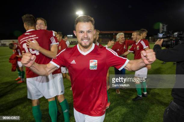 Alex Svedjuk and team mates celebrate following a 4 2 victory for Karpatalya against Szekely Land during the Conifa Paddy Power World Football Cup...