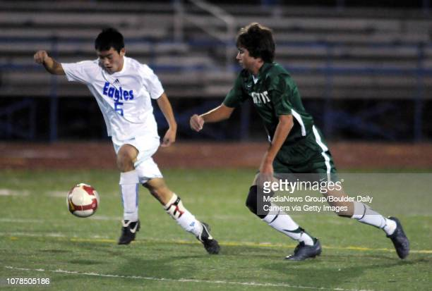 Alex Tagawa left Broomfield keeps the ball from Chris Gurule Niwot during play Wednesday at Elizabeth Kennedy Stadium October 29 2008 staff photo/...