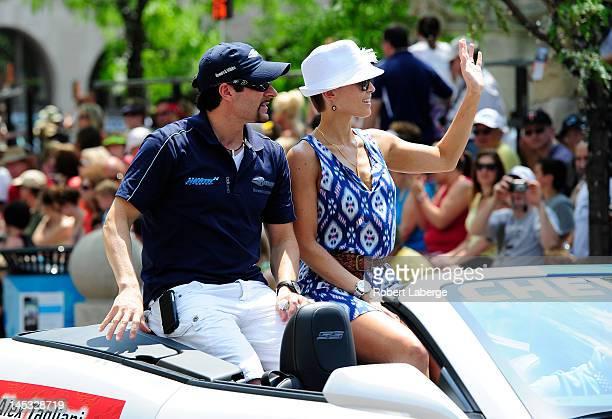 Alex Tagliani of Canada driver of the Bryan Herta Autosport w/Curb Agajanian Dallara Honda with his wife Bronte during the Indianapolis 500 Festival...