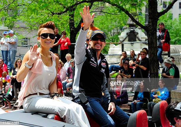 Alex Tagliani of Canada driver of the Sam Schmidt Motorsports Dallara Honda with his wife Bronte during the parade for the 100th Anniversary of the...
