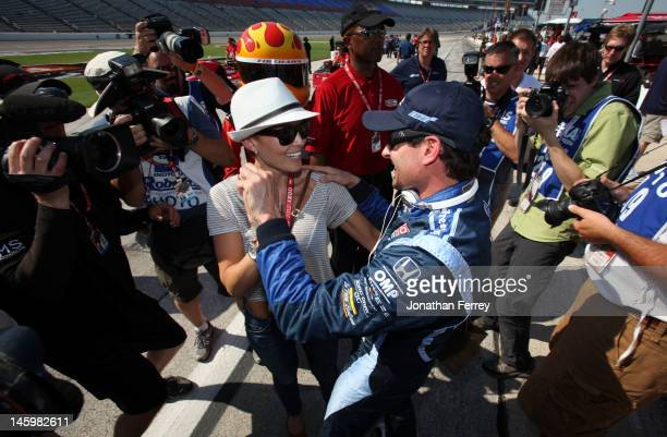 Alex Tagliani of Canada driver of the Team BarracudaBHA Honda Dallara celebrates winning the pole position with his wife Bronte during qualifying for...