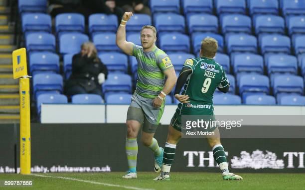 Alex Tait of Newcastle celebrates scoring a try during the Aviva Premiership match between London Irish and Newcastle Falcons at Madejski Stadium on...