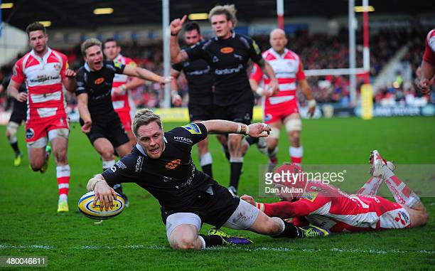 Alex Tait of Newcastle Falcons beats the tackle of Rob Cook of Gloucester to score a try during the Aviva Premiership match between Gloucester and...