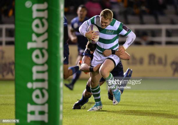 Alex Tait of Newcastle Falcons breaks free of Pierre Gayraud of Bordeaux to scores a try in the second half during the European Rugby Challenge Cup...