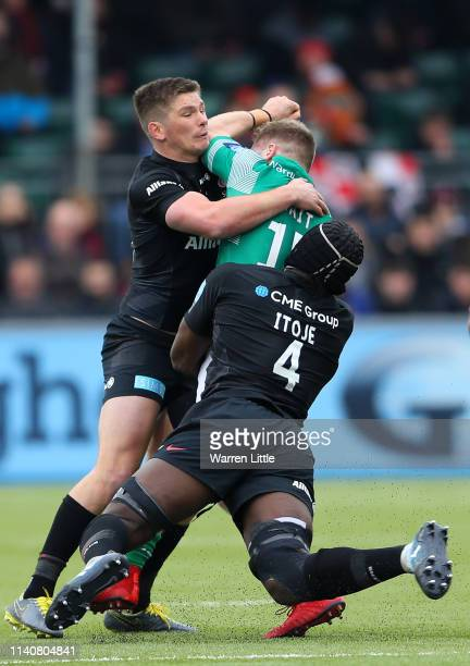 Alex Tait of Newcastle Falcons is tackled by Owen Farrell Saracens Captain and Maro Itoje during the Gallagher Premiership Rugby match between...