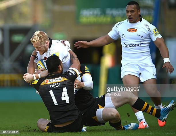 Alex Tait of Newcastle Falcons is tackled by Will Helu of London Wasps during the Aviva Premiership match between London Wasps and Newcastle Falcons...