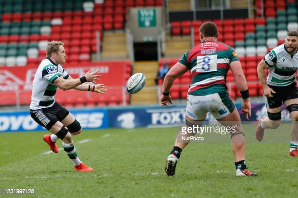 Alex Tait of Newcastle Falcons offloads during the Gallagher Premiership match between Leicester Tigers and Newcastle Falcons at Welford Road,...