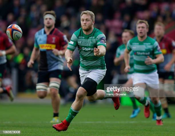 Alex Tait of Newcastle Falcons passes the ball during the Premiership Rugby Cup match between Harlequins and Newcastle Falcons at Twickenham Stoop on...