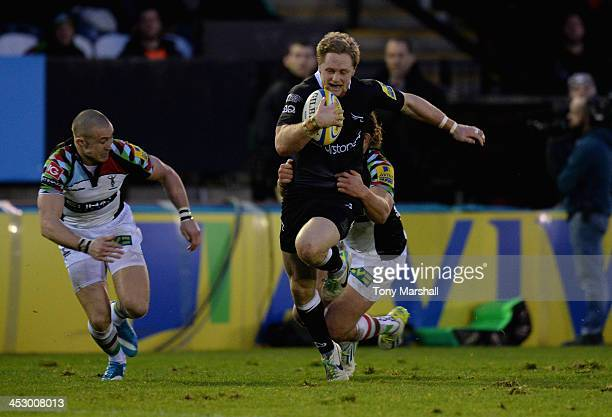 Alex Tait of Newcastle Falcons tackled by Luke Wallace of Harlequins during the Aviva Premiership match between Newcastle Falcons and Harlequins at...
