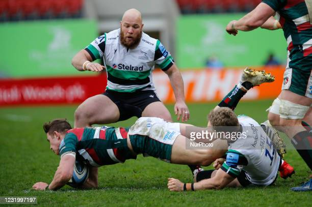 Alex Tait of Newcastle Falcons tackles his opposite number, Freddie Steward during the Gallagher Premiership match between Leicester Tigers and...