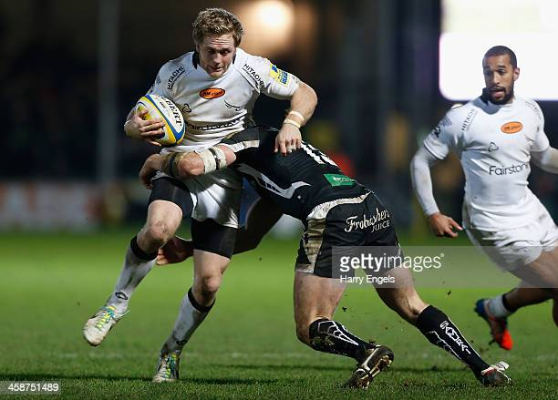 Alex Tait of Newcastle is tackled by Danny Barnes of Exeter during the Aviva Premiership match between Exeter Chiefs and Newcastle Falcons at Sandy...