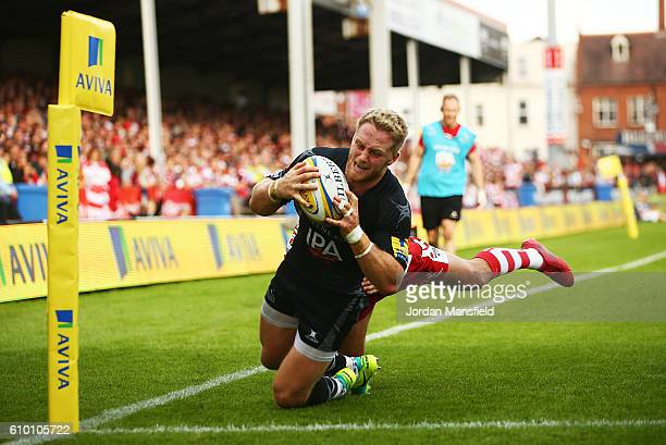 Alex Tait of Newcastle touches down a try during the Aviva Premiership match between Gloucester Rugby and Newcastle Falcons at Kingsholm Stadium on...