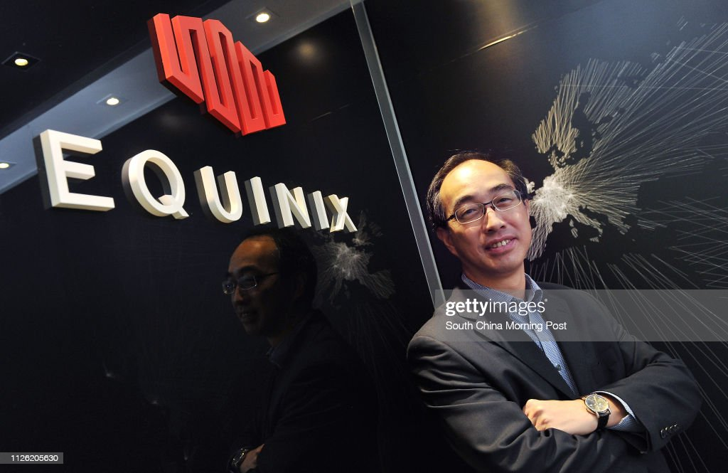 Alex Tam Wing-yiu, managing director at data centre operator Equinix, poses for a photograph, Wan Chai. 20JUN14 : News Photo