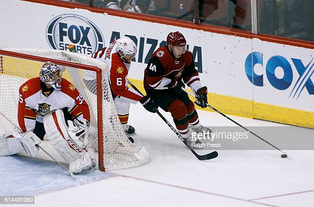 Alex Tanguay of the Arizona Coyotes skates with the puck behind goaltender Al Montoya of the Florida Panthers as Alex Petrovic of the Panthers...