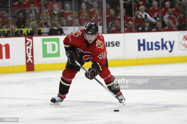 Alex Tanguay of the Calgary Flames handles the puck against the Detroit Red Wings in Game 6 of the 2007 Western Conference Quarterfinals at Pengrowth...