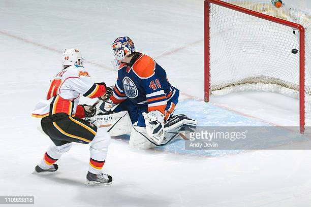 Alex Tanguay of the Calgary Flames scores on his shootout attempt on Devan Dubnyk of the Edmonton Oilers at Rexall Place on March 26 2011 in Edmonton...