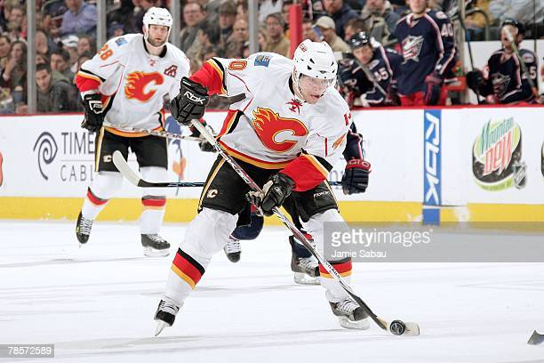 Alex Tanguay of the Calgary Flames skates with the puck against the Columbus Blue Jackets on December 18 2007 at Nationwide Arena in Columbus Ohio