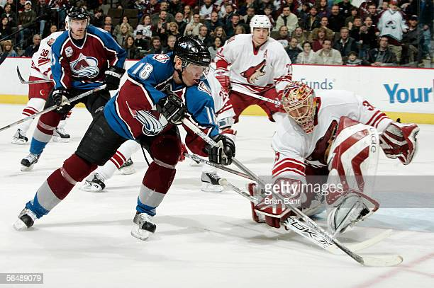 Alex Tanguay of the Colorado Avalanche can't get the puck past goalie Brian Boucher of the Phoenix Coyotes as he curls around the crease in the third...