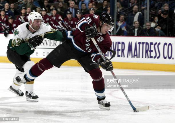 Alex Tanguay of the Colorado Avalanche scores a second period goal during the game against the Dallas Stars on January 26, 2006 at Pepsi Center in...