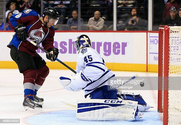 Alex Tanguay of the Colorado Avalanche shoots the puck past goalie Jonathan Bernier of the Toronto Maple Leafs for a goal to tie the score 22 in the...