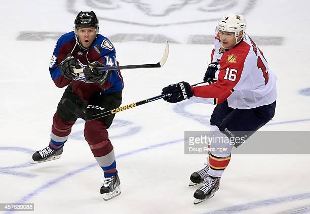 Alex Tanguay of the Colorado Avalanche tries to control the puck against Aleksander Barkov of the Florida Panthers at Pepsi Center on October 21 2014...