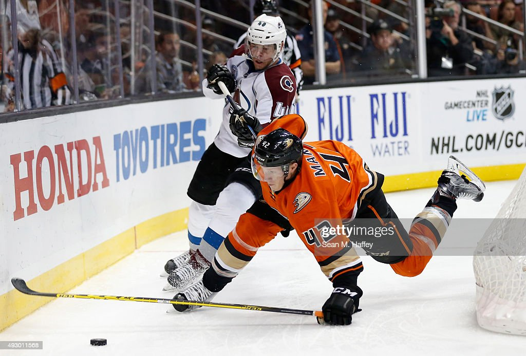 Alex Tanguay #40 of the Colorado Avalanche trips Josh Manson #42 of the Anaheim Ducks during the second period of a game at Honda Center on October 16, 2015 in Anaheim, California.