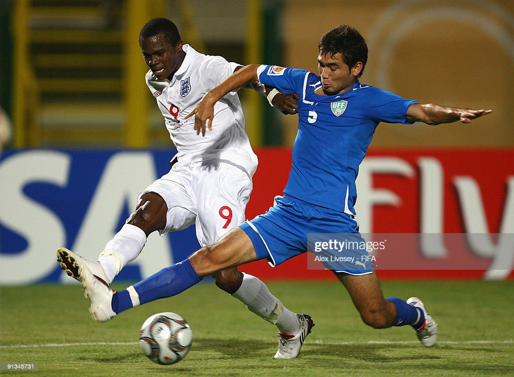 Alex Tchuimeni-Nimely of England is tackled by Dilyorbek Irmatov of Uzbekistan during the FIFA U20 World Cup Group D match between Uzbekistan and England at the Mubarak Stadium on October 2, 2009 in Suez, Egypt.