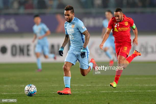Alex Teixeira of China's Jiangsu FC controls the ball during the AFC Champions League group stage football match against Australia's Adelaide United...