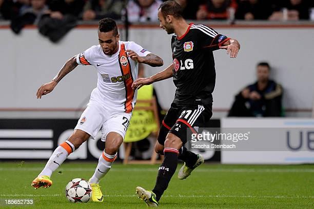 Alex Teixeira of Donetsk vies with Oemer Toprak of Leverkusen during the UEFA Champions League Group A match between Bayer Leverkusen and Shakhtar...