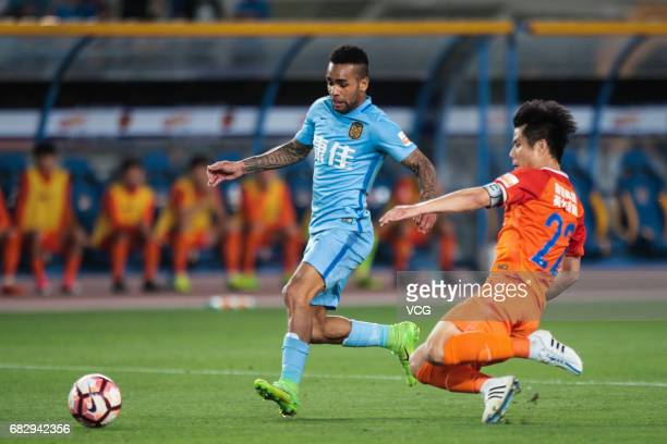 Alex Teixeira of Jiangsu Suning and Hao Junmin of Shandong Luneng vie for the ball during 2017 Chinese Super League 9th round match between Jiangsu...