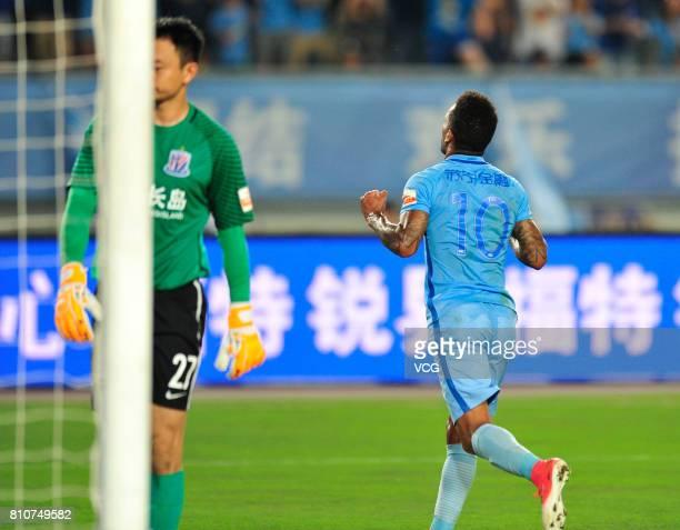 Alex Teixeira of Jiangsu Suning celebrates a point during the 16th round match of 2017 Chinese Football Association Super League between Jiangsu...