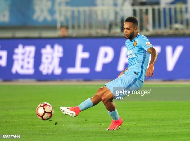Alex Teixeira of Jiangsu Suning drives the ball during the 13th round match of 2017 Chinese Football Association Super League between Jiangsu Suning...
