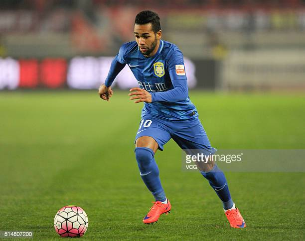 Alex Teixeira of Jiangsu Suning drives the ball during the Chinese Football Association Super League match between Jiangsu Suning and Yanbian Funde...