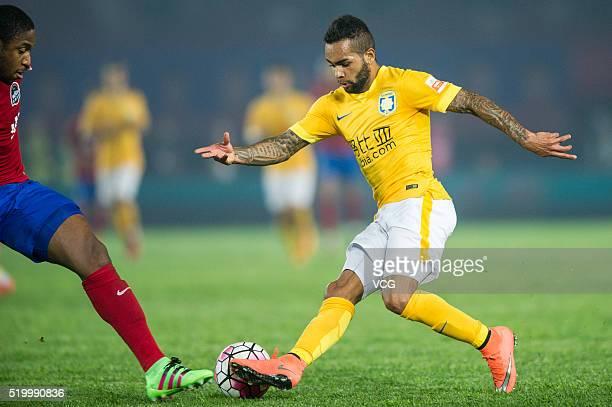 Alex Teixeira of Jiangsu Suning drives the ball during the Chinese Football Association Super League match between Henan Jianye and Jiangsu Suning at...