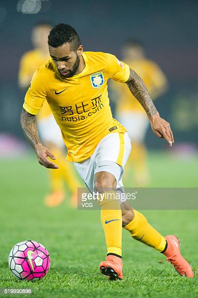 Alex Teixeira of Jiangsu Suning drives the ball during the Chinese Football Association Super League match between Henan Jianye and Jiangsu Suning at...