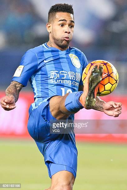 Alex Teixeira of Jiangsu Suning kicks during the final second leg of Yanjing Beer 2016 Chinese Football Association Cup between Guangzhou Evergrande...