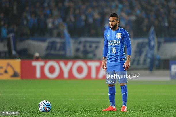 Alex Teixeira of Jiangsu Suning prepares for a free kick during the AFC Champions League Group E match between Jiangsu Suning and FC Tokyo at Nanjing...