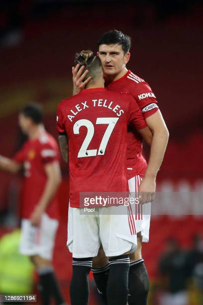 Alex Telles and Harry Maguire of Manchester United celebrate following their team's victory in the Premier League match between Manchester United and...