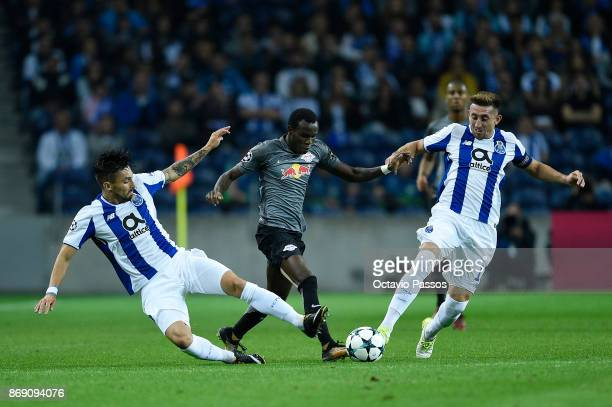 Alex Telles and Hector Herrera of FC Porto competes for the ball with Bruma of RB Leipzig during the UEFA Champions League group G match between FC...